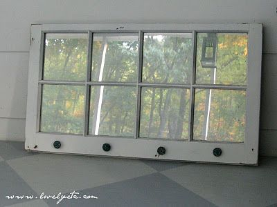 """Window to mirror with """"Looking Glass"""" spray paint.  Love the layered paint on the knobs, too!"""