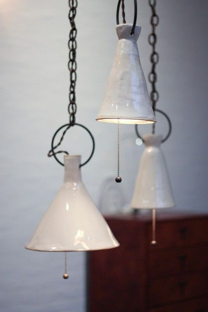 Ceramic Funnel Lamps by Natalie Page via BDDW I Remodelista | Love the wabi sabi quality of these pendants.