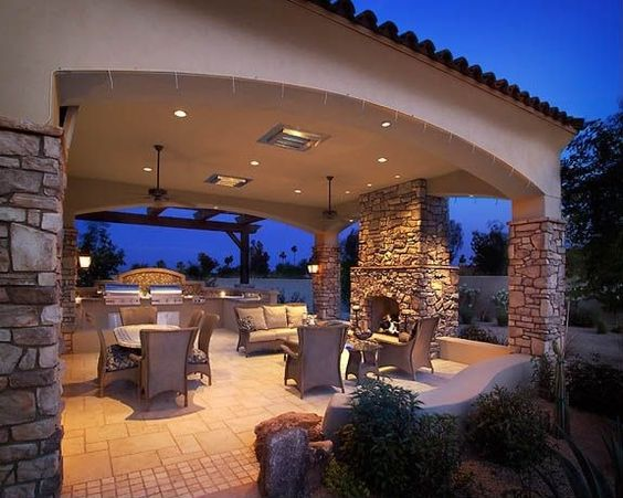 Mediterranean Patio with exterior stone floors Fence
