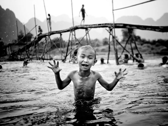 After school fun at the river, in Laos. (© Danny Griffin)