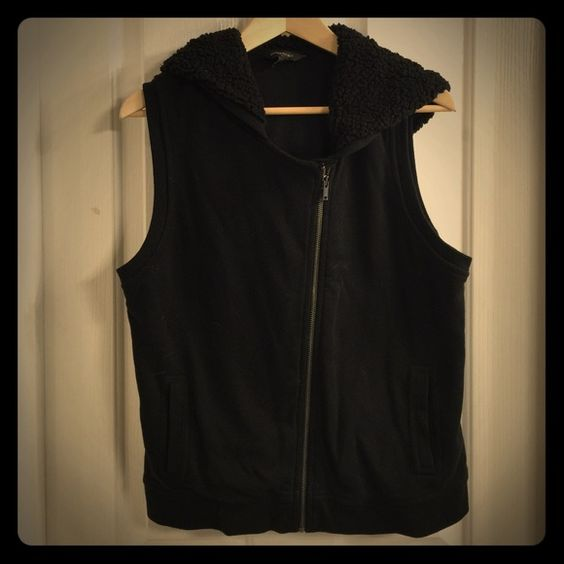 "Banana Republic Moto Vest Black moto vest with an asymmetrical zip and a soft sherpa hood. Front slant pockets. 60% Cotton. 40% Polyester. 24"" Long. 19"" Armpit to armpit. Banana Republic Jackets & Coats Vests"