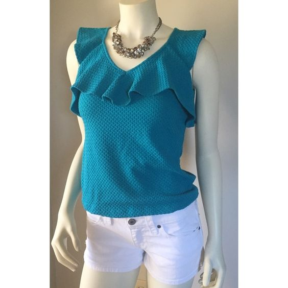 DELETTA anthro teal Aqua textured feminine top XS Soft and comfortable stretch material. Pull over the head style. I am 5'4 34C and it was slightly too snug under my armpits otherwise it was a nice fit. Excellent condition! No stains no tears. Just some light wash wear. Pit to pit across front 16 inches. Shoulder to bottom 20 3/4 inches Deletta Tops Blouses