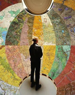 Step into a globe, and see the map from the inside out, by Joyce Kozloff, shown at the blog une brique rose de plus..
