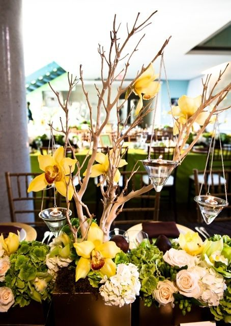 Manzanita tree centerpieces yellow orchid and