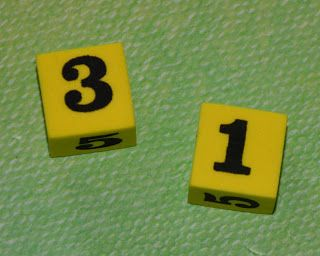 simple math dice game- which number is bigger (can also introduce greater than, less than, and equal to)