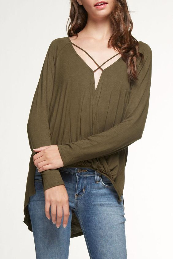 This long sleeve Olive knit top has it going on! A strappy criss-cross front splits from the hi-lo hem at just the right spot. This looks great with a black bralette and one of this season's great vests! Hand wash, line dry.   Criss Cross High Low Top by Mittoshop. Clothing - Tops - Long Sleeve Pennsylvania