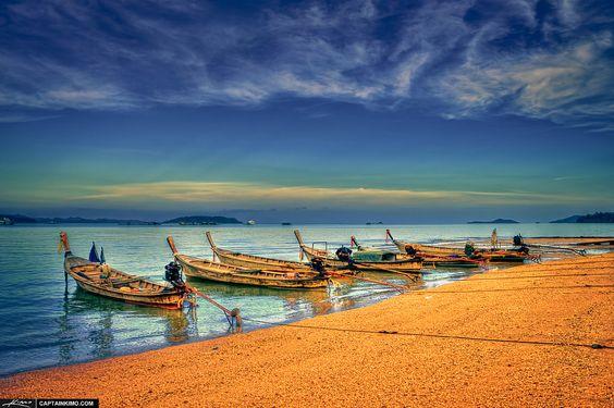 Boats from a local fishing village at Ao Po Marina, Phuket, Thailand.