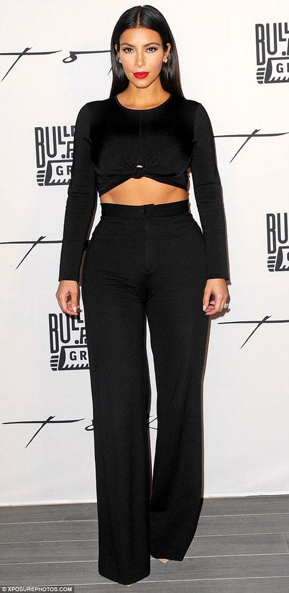 Cream of the crop: Kim Kardashian showed off her toned midriff in a black crop top and tro...: