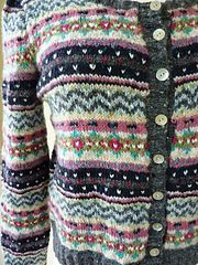 An exciting, colourful cardigan with an all over Fair Isle pattern. The cardigan has a 1940s feel.