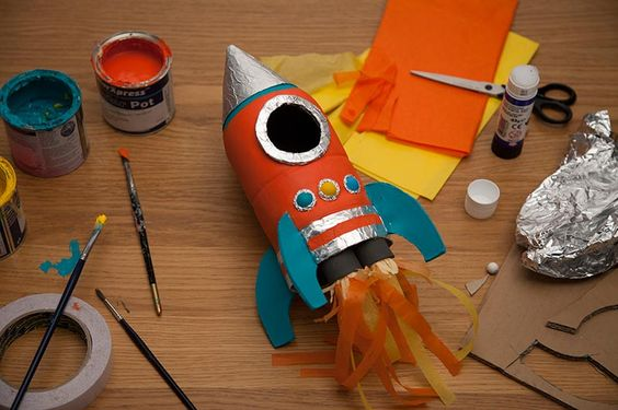 Let your kids explore outer space by transforming and empty soda bottle into a rocket ship!