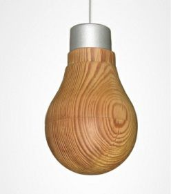 A LED bulb covered in a thin wooden shell that lets the light shine through by Ryosuke Fukusada.