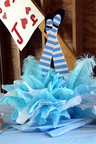 Parties & Surprises - Alice in Wonderland Party - hand painted alice legs with wonderful feathers act as the base for this centerpiece: