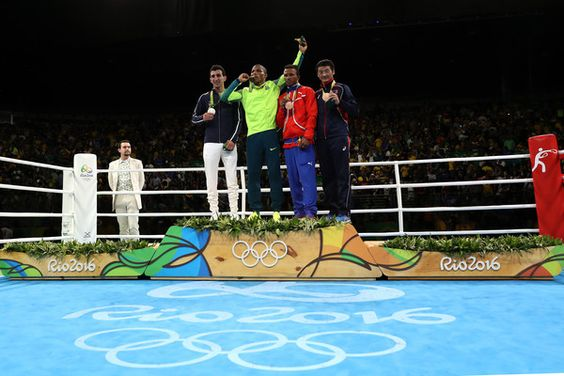 L-R) Silver medalist Sofiane Oumiha of France, gold medalist Robson Conceiçao of Brazil, bronze medalist Lazaro Jorge Alvarez of Cuba and bronze medalist Otgondalai Dorjnyambuu of Mongolia stand on the podium during the medal ceremony for the Men's Light (60kg) boxing event on Day 11 of the Rio 2016 Olympic Games at Riocentro - Pavilion 6 on August 16, 2016 in Rio de Janeiro, Brazil.