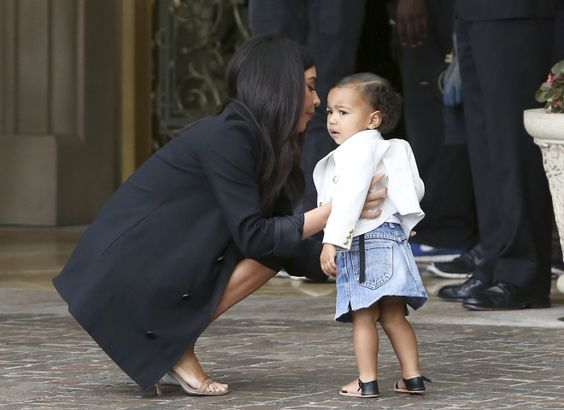 North does denim as she stays close to mom uponarrival.