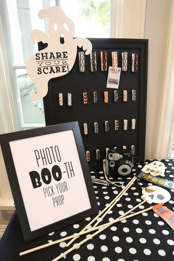 We hosted an afternoon kids' Halloween party with a modern twist by painting pumpkins for decor (great to display around the home after the party) and setting up candy cornhole, a photo booth and a bubble station: