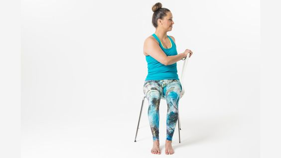 Seated Twist with using the back side of the chair to engage a bit more into twist.  Chin stays aligned with the chest to help keep the twist in the mid spine. #ChairYogaFitness with #Gaileee Love Chair Yoga