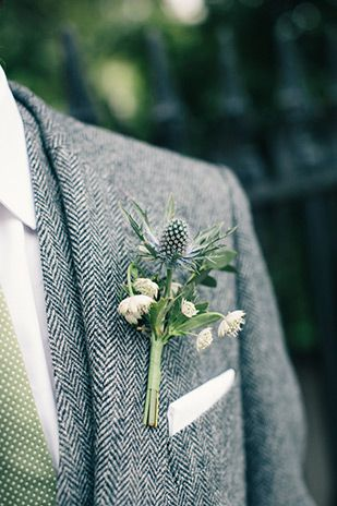 Love this groom's tweed suit paired with a green and white polka dot tie and green boutonniere  | www.onefabday.com