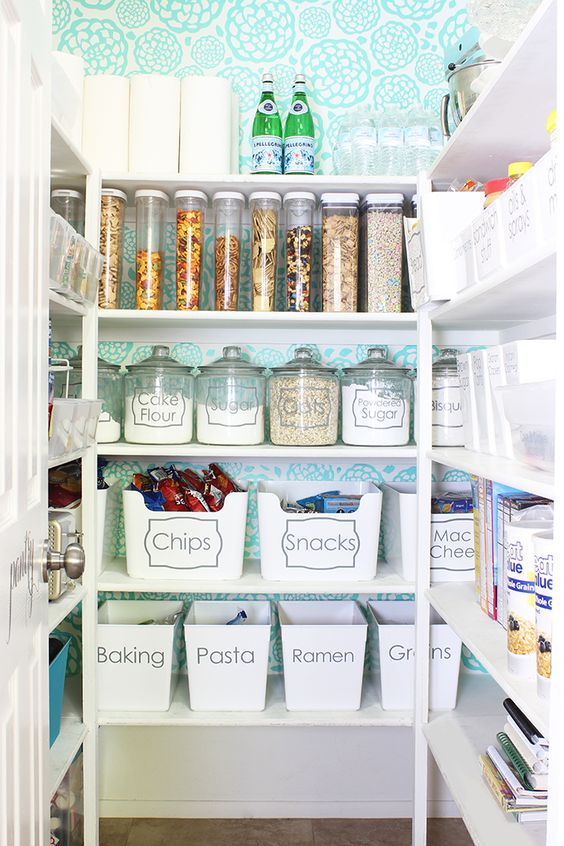 Tons of Organized Kitchen Pantry Ideas. Love the clean look of the bins and glass jars!
