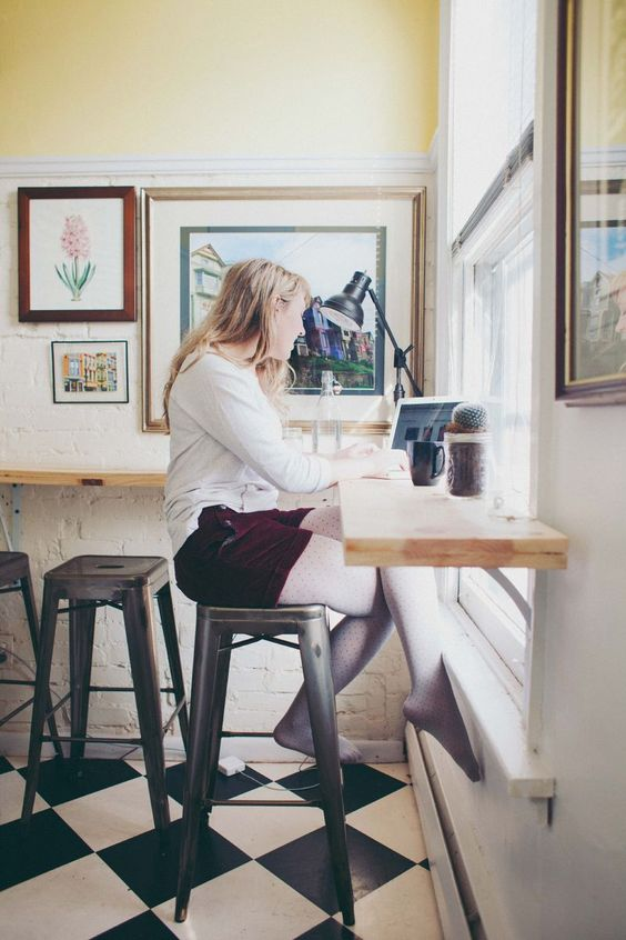 """""""I realized pretty early on, with limited floor space, I'd have to move up on the walls. And because it is a rented space, any changes I made had to be temporary. My pictures turned into magnets on the fridge. My pots and pans went into the air. I didn't have room for a kitchen table, so I built a wrap around coffee bar for the walls (inspired by Emma's standing desk, actually!). I have hanging mason jars in the bathroom and wire file storage hanging by my desk. To make the room look bigger…"""