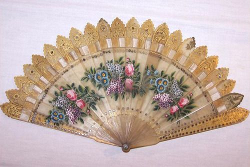 oh my goodness...this is such a beautiful fold-out hand fan....stunning....