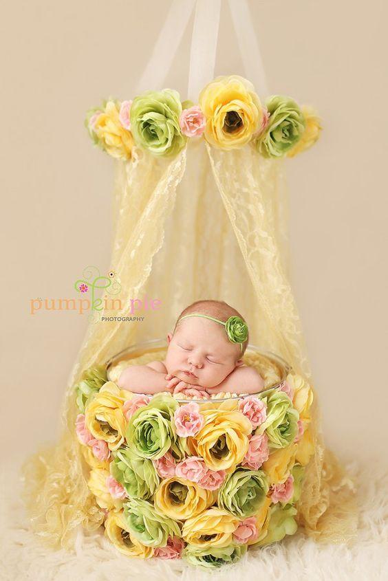 Hot glue some flowers all around a basket for a cute newborn prop.
