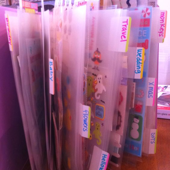 Scrapbook stickers organized in sheet protectors and for the smaller ones, baseball card holders.