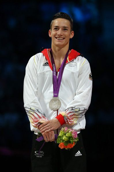 Marcel Nguyen of Germany smiiles as he celebrates with his silver medal on the podium during the medal ceremony for the Artistic Gymnastics Men's Individual All-Around final on Day 5 of the London 2012 Olympic Games at North Greenwich Arena on August 1, 2012