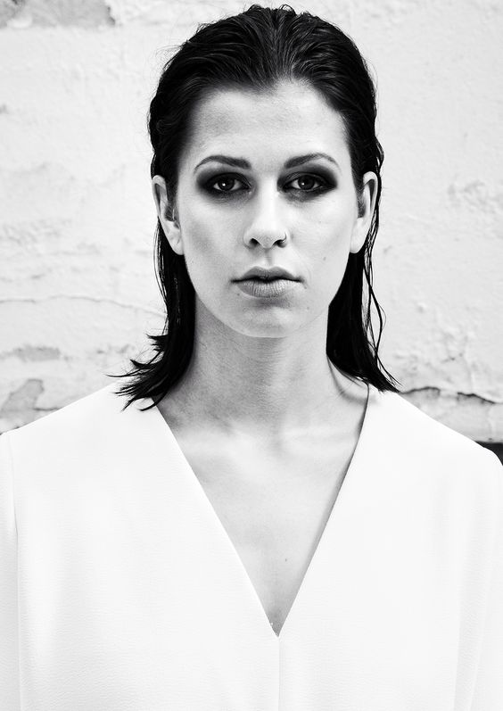 SERIES ONE on www.schwarzersamt.com is a black and white photo shoot with a COS blouse. It's a beauty shot with smoky eyes and wet hair and sleek hair