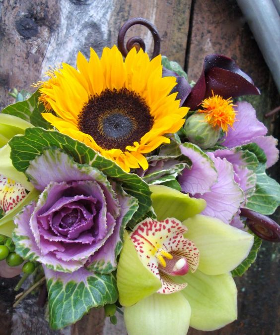 fall bouquet of sunflowers, kale, orchids, mini calla lillies, hydrangea, safflower, and fiddleheads!