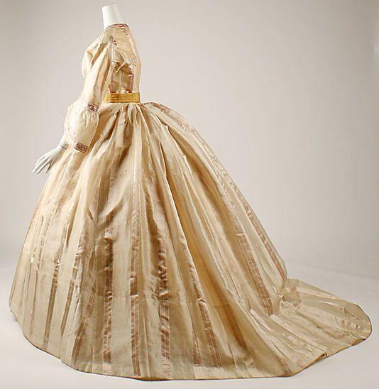 "Gold silk dress (side view, day bodice), French, ca. 1865. Label: ""Mme. Marguerite Robes, 6 rue de Miromenil, Paris"""