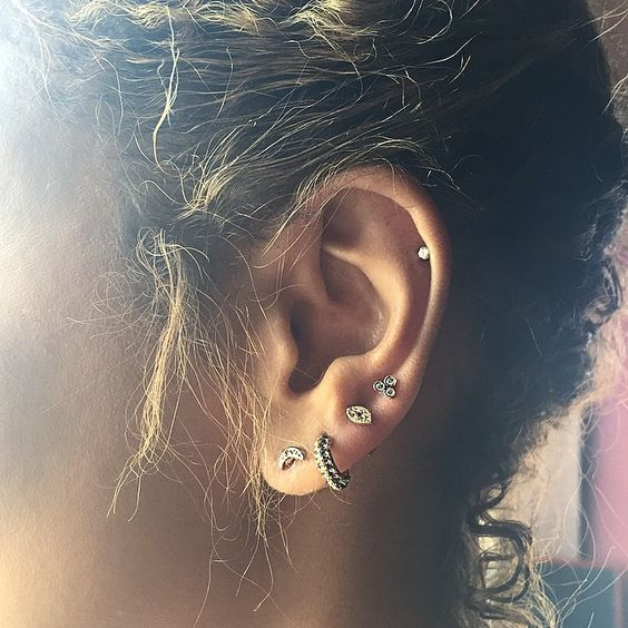 New piercing and new @jacquieaiche bling from her super cute piercing event last night. Triple diamond stud and ruby evil eye added to my lobe collection. #LA #jacquieaiche. Piercing @bodyelectrictattoo