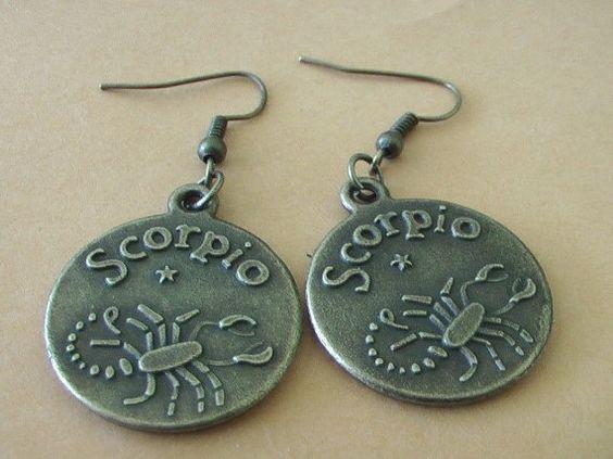 "Bronze Scorpio dangling circle earrings that w/ ""Scorpio"" & a scorpion carved in"