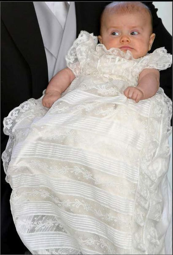 Princess Estelle wearing  the same baptismal gown worn by Swedish royals since 1907.
