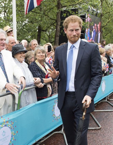 "Prince Harry greets guests attending ""The Patron's Lunch"" celebrations for The Queen's 90th birthday on The Mall on June 12, 2016 in London, England."