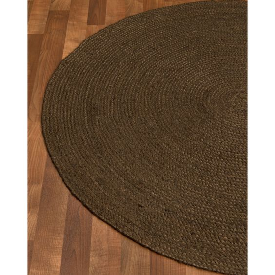 All natural 100% Jute, hand woven by Artisan rug makers. Jute is naturally durable yet soft.  Variations are part of the natural beauty of natural fiber.