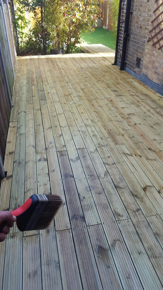 Treating newly laid decking with deck sealer and protector