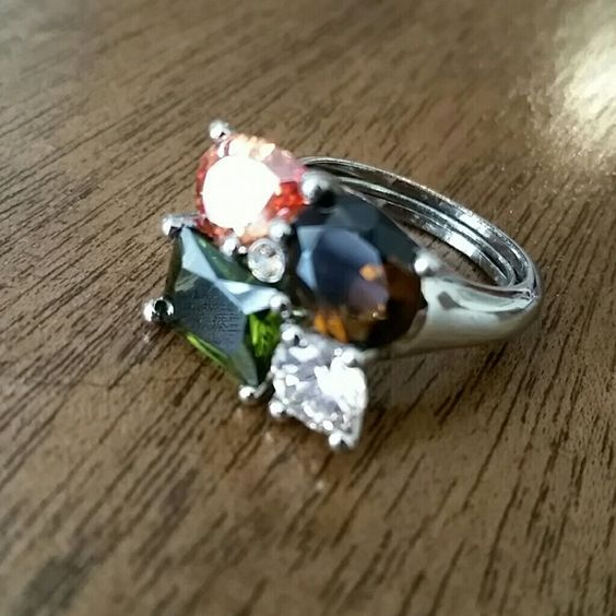 Cocktail Ring size 8 Gorgeous multi color gemstones.  Like new. The stones on this ring resemble smoky quartz, citrine, peridot and diamond or similar. Silver tone Has ring guard inside. Size 8 Jewelry Rings