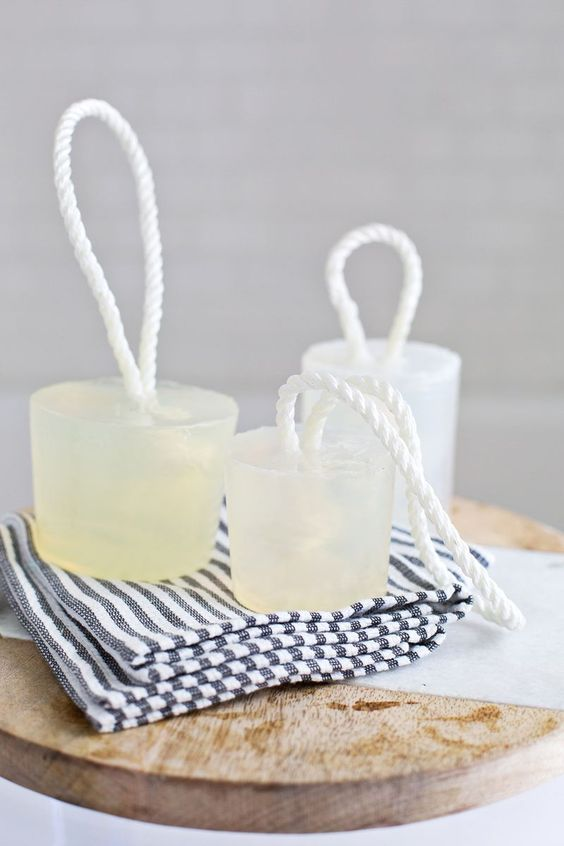 Not only does the white rope make these soaps perfect for a nautical bathroom, but it also makes shower storage a snap. Get the tutorial at A Beautiful Mess »  - GoodHousekeeping.com