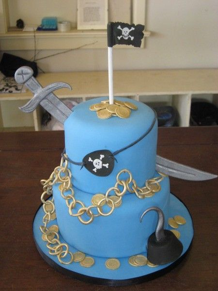 Pirate Cake- like the hook and the sword THROUGH the cake
