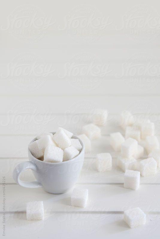 Sugar cubes on white background by Emoke Szabo