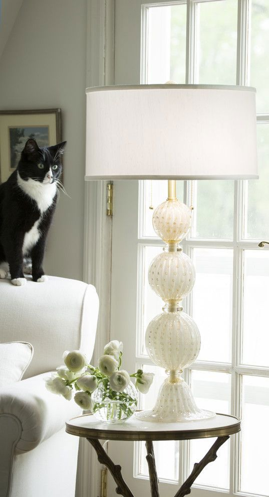 white Murano glass lamp in the living room with cute black and white cat; Venetian glass lamp; Murano glass lamps