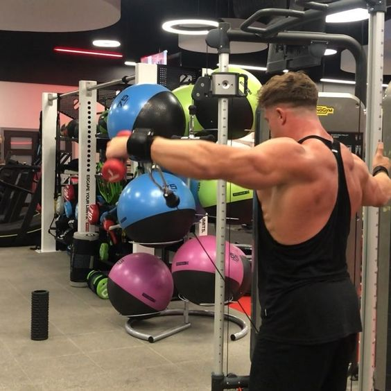 . CABLE SIDE RAISES - I tried a new variation today after seeing some guy whos bigger than me do it which means Ill be as big as him soon right? - I really liked pulling with a strap. When I hold a handle I feel a lot of strain through my wrist and lose s