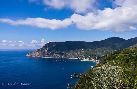Italy -- High up on a Cinque Terre Hiking Trail by David.Kamm, via Flickr -- A beautiful view of the distant Cinque Terre village of Monterosso al Mare. We stopped just long enough to capture a few photos from this great vantage point along the hiking trail between Monterosso al Mare and Vernazza. It takes about 90 minutes to hike this segment, with a few steep up/down portions of trail. But the views are worth it, and people of nearly all shapes, sizes, and ages make this trek.