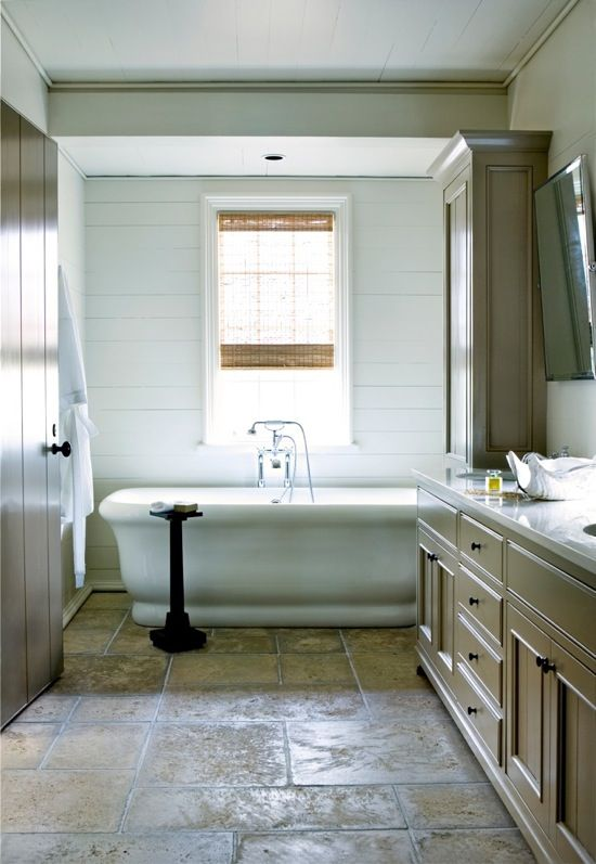 Soffit over tub to define the space  cabinetry at end of tub for storage and. Soffit over tub to define the space  cabinetry at end of tub for