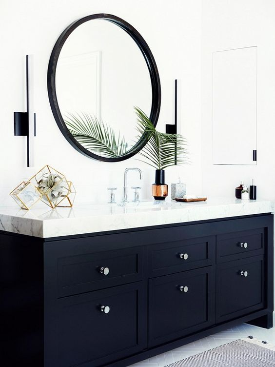 Black painted vanity with thick white marble counter and modern sconces. // @consortdesign Design by Mat Sanders and Brandon Quattrone