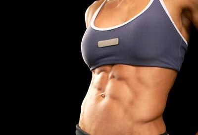 Trainers' Favorite Exercises for a Flat Belly // woman with flat abs c Thinkstock