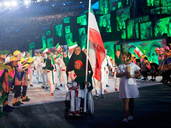 Iran's flag bearer at the opening ceremony was an athlete who became an archer after she was paralyzed in a car accident