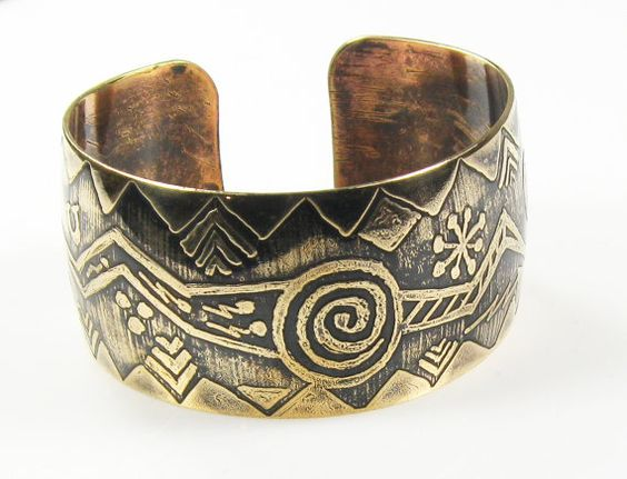 Shaman's Ritual Cuff Bracelet -   Hand-painted Shaman inspired design, etched on a brass cuff bracelet. The design will keep you intrigued with its mysterious Life Path symbols.