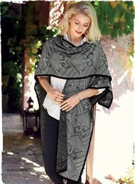 Black and white geometrics from a Laotian textile pattern our versatile layering piece. Wear it anchored by buttons at the side seams or draping, unbuttoned, as a shawl.