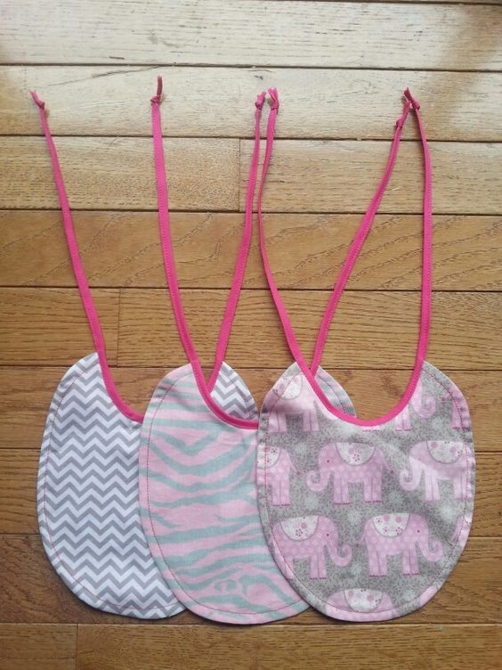 Small bibs made with left over squares from crib sheets.
